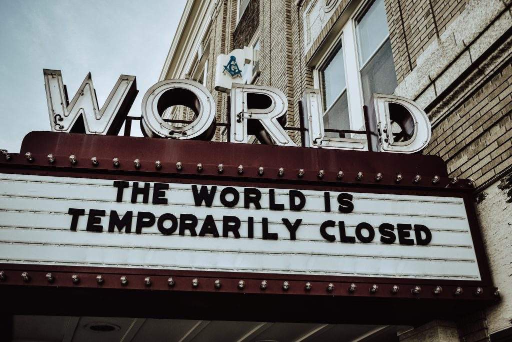 """movie marquee reading """"The world is temporarily closed."""""""